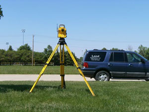 LE Land Surveying Services robotic instrument taking measurements